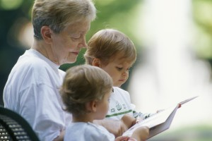elderly woman reading to children