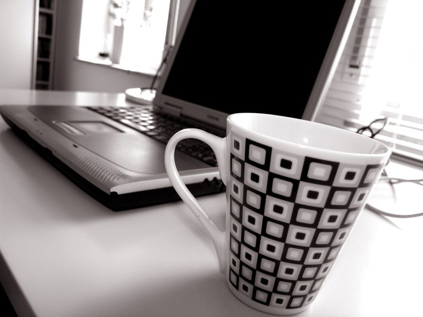 Laptop and coffee mug photo