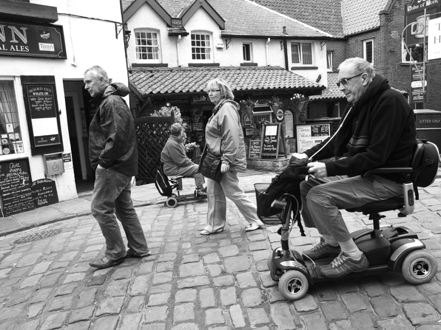 Mobility scooter on cobbled street