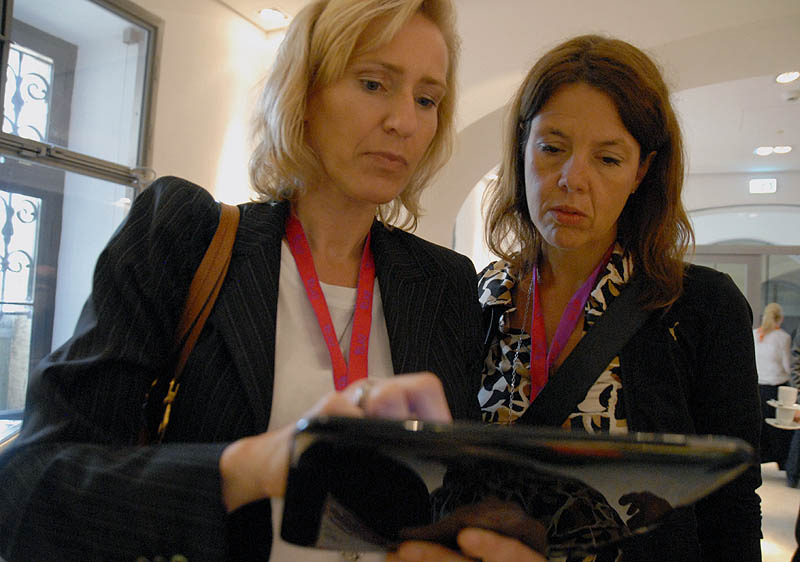 Two women using a tablet computer.