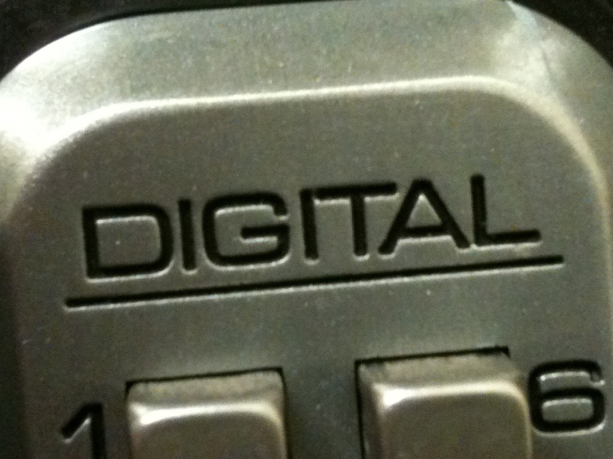The Word 'Digital' on metal