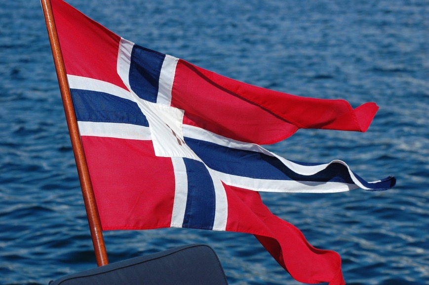 Split Norwegian flag flying in the wind