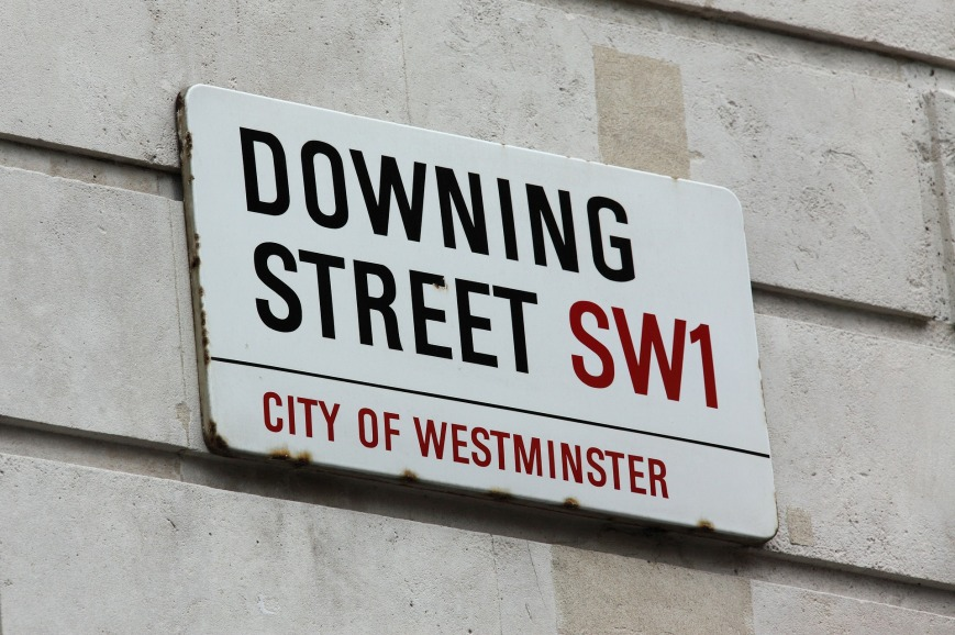 A sign with the words 'Downing Street'.