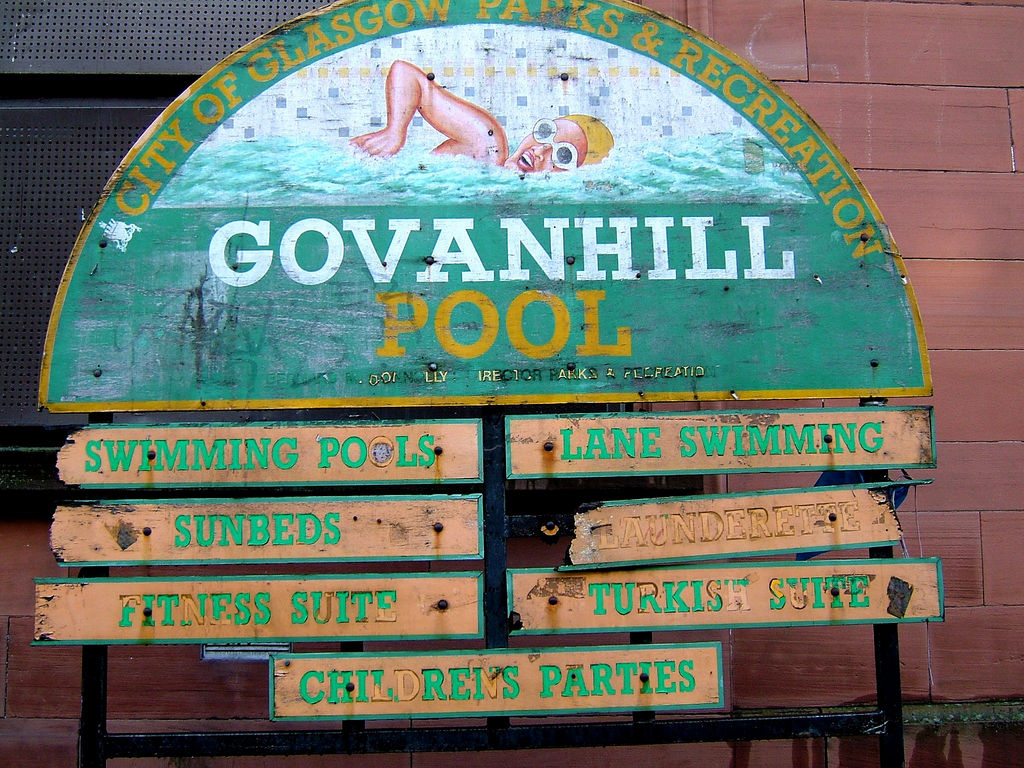 A run-down looking sign for the Govanhill Baths.