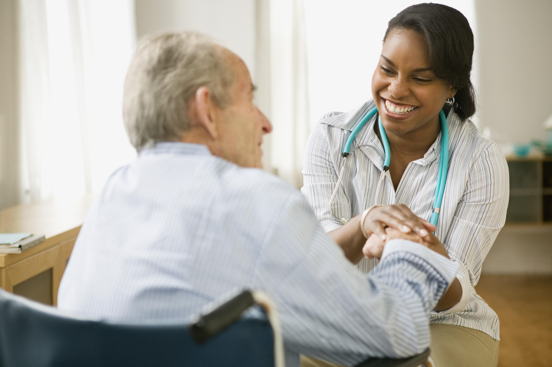 Nurse and elderly man spending time together --- Image by © Jose Luis Pelaez, Inc./Blend Images/Corbis