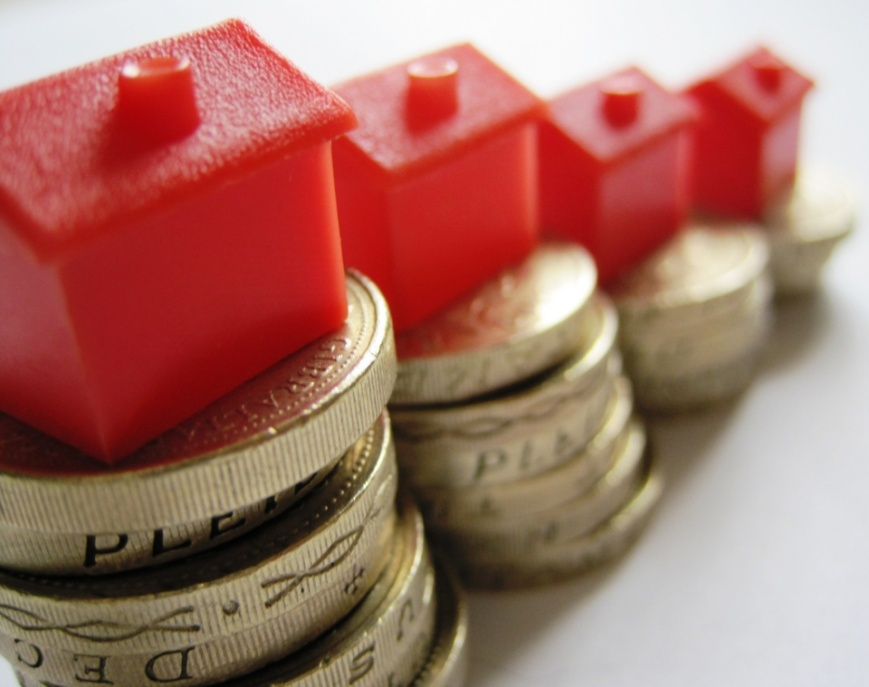 Houses-on-coins-by-Images-Money