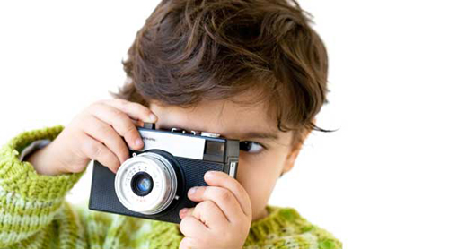 kid-taking-photos-with-cheap-digital-camera