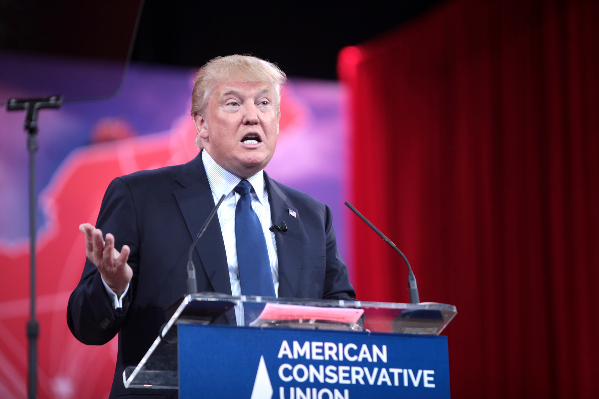 Donald Trump standing on a podium