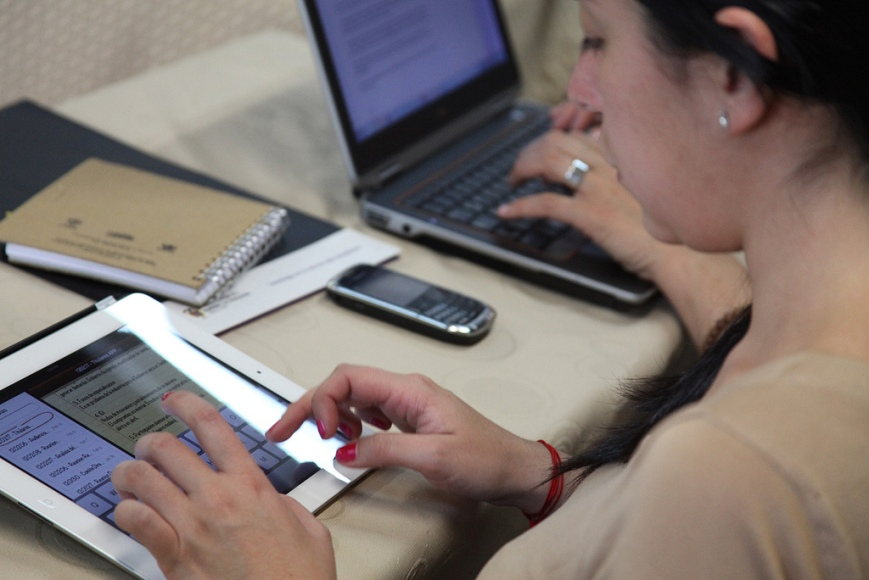A woman using a tablet computer