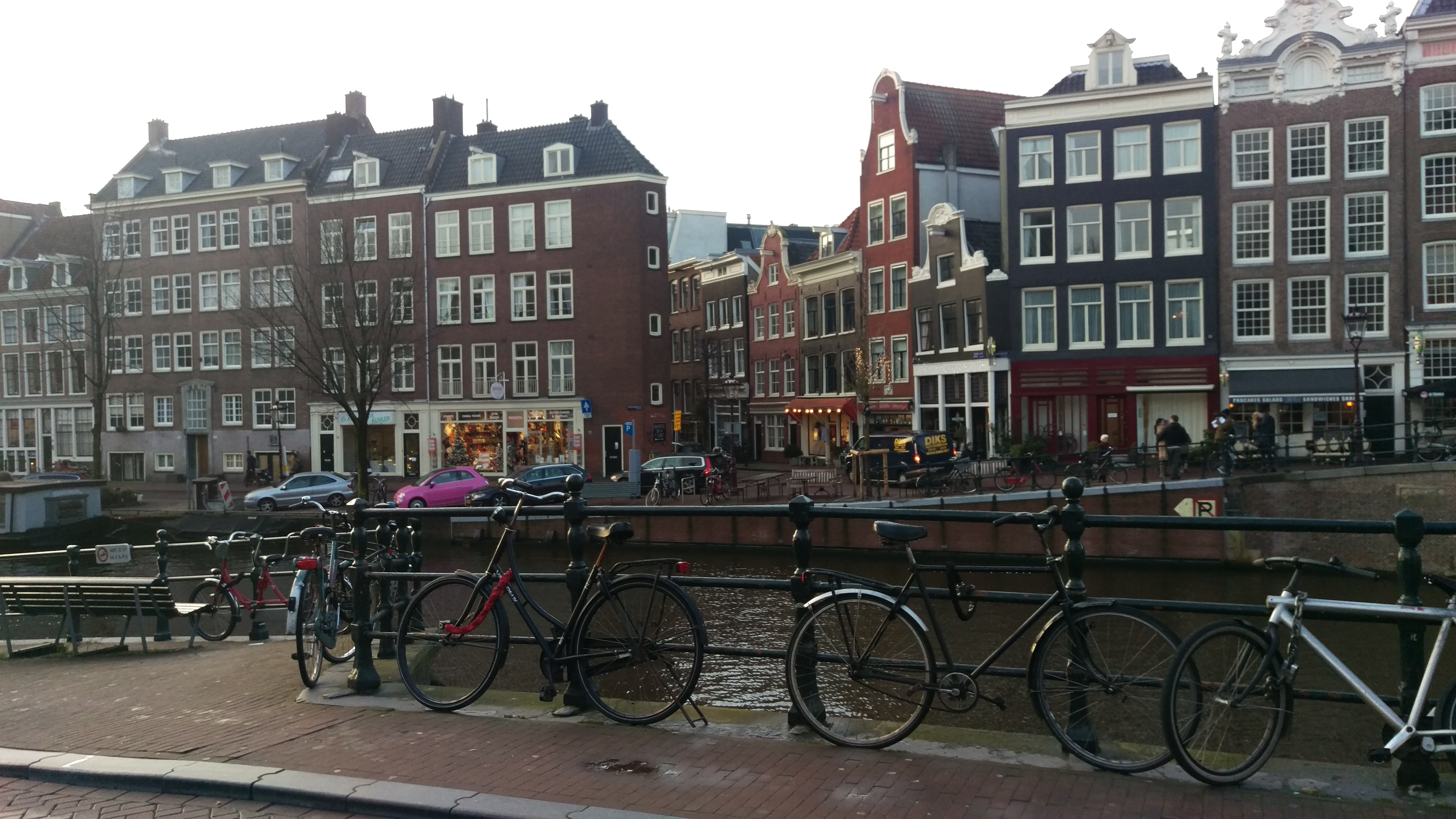 Buildings with bikes parked next to the canal, Amsterdam.