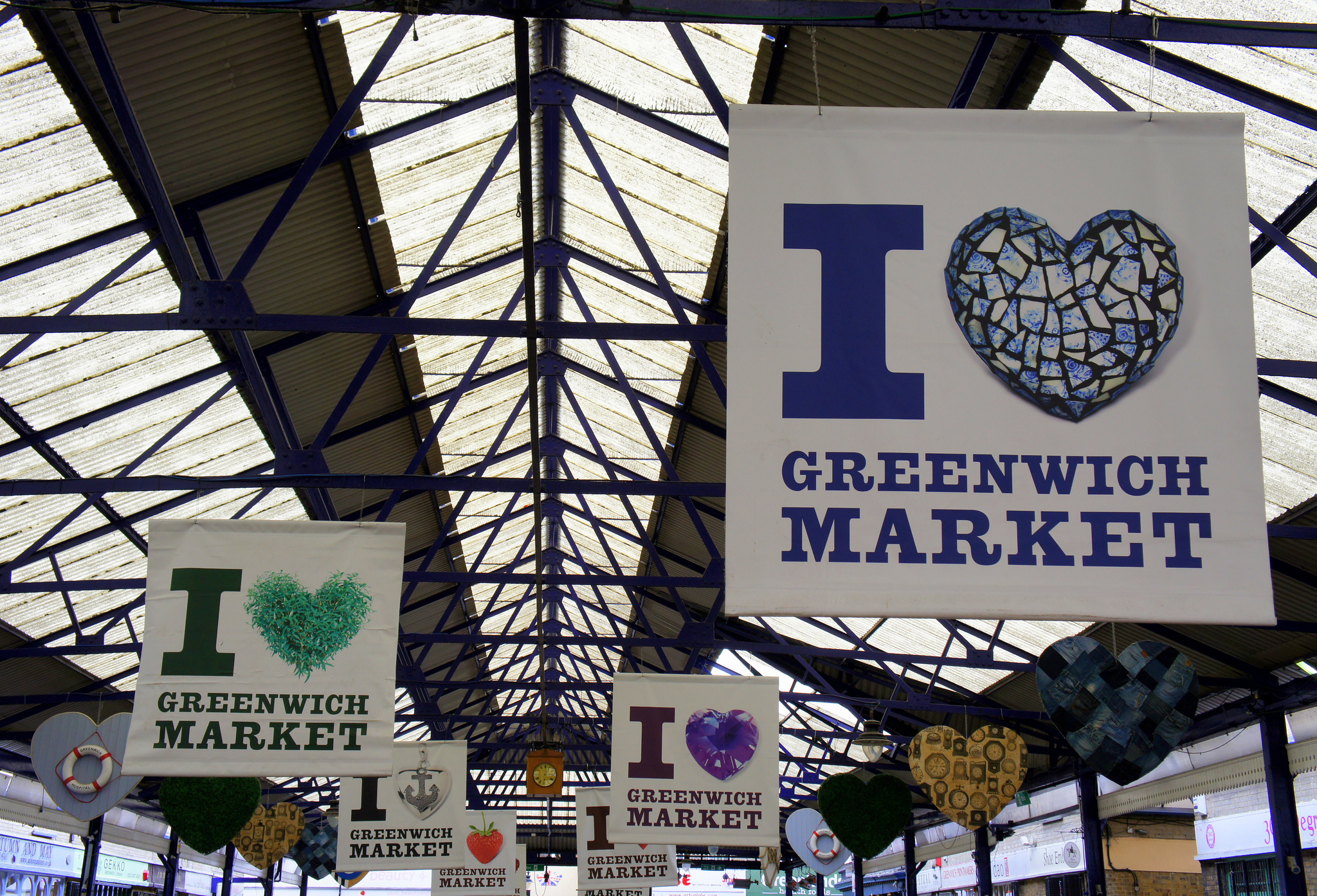 Image of I love Greenwich flags hanging in a market