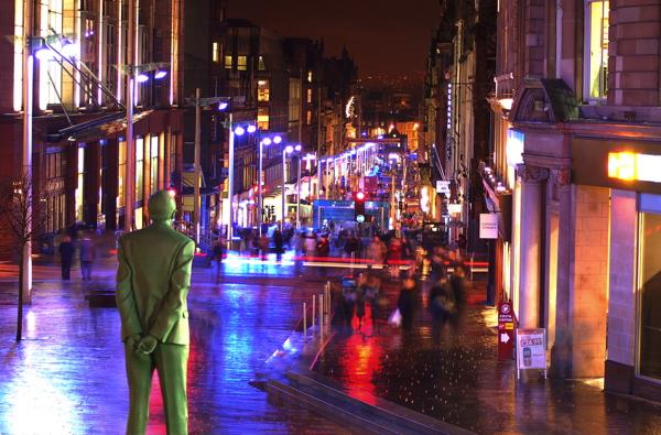 Statue of Donald Dewar looking down onto Buchanan Street, Glasgow