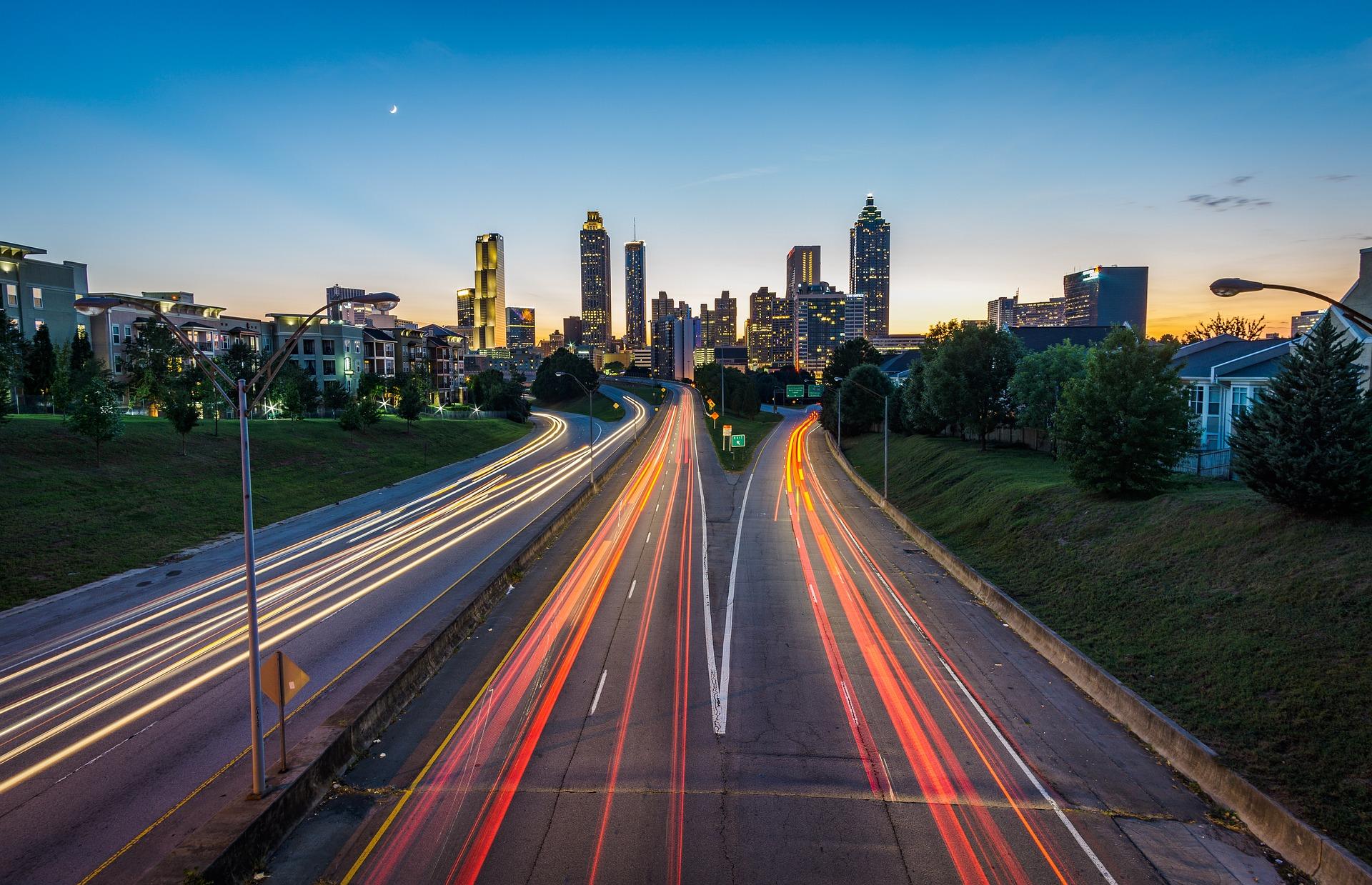 Light-streamed highways heading towards the city