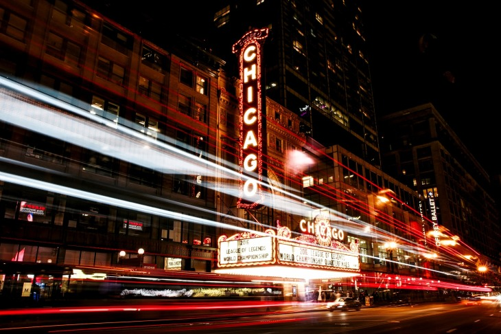 Outside a Chicago theatre, with a huge 'Chicago' sign outside