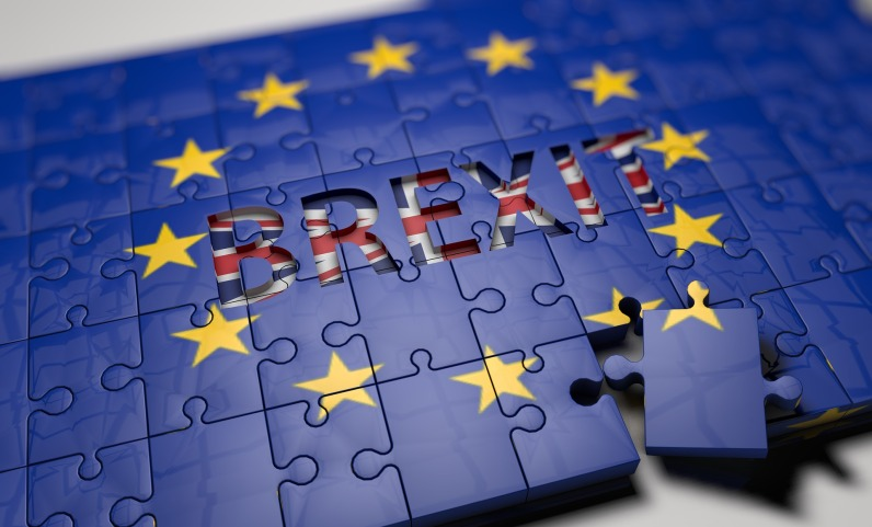 The EU flag, with the Brexit on it appear, in the form of a jigsaw puzzle.