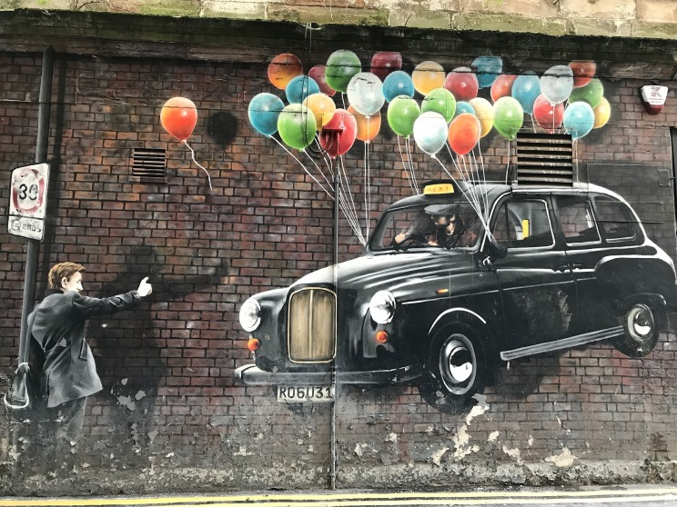 Mural of a taxi being elevated by ballons, Glasgow