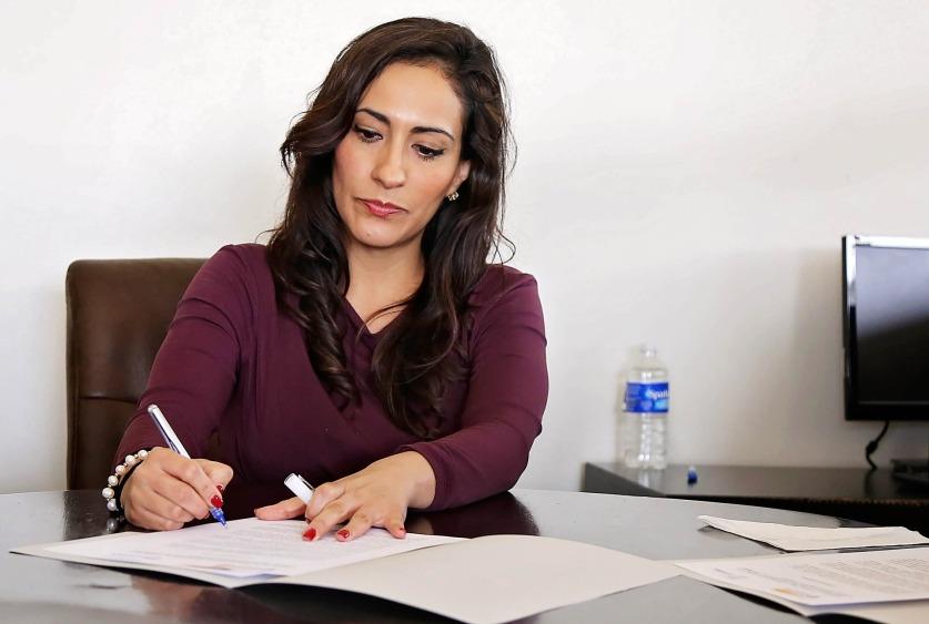 Women sitting at her desk doing paperwork