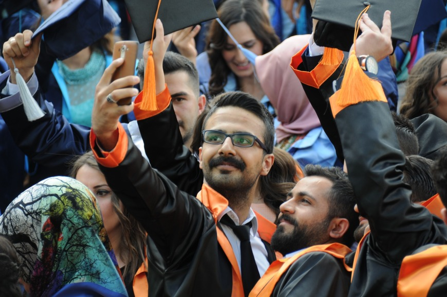 Two guys taking a selfie at graduation.